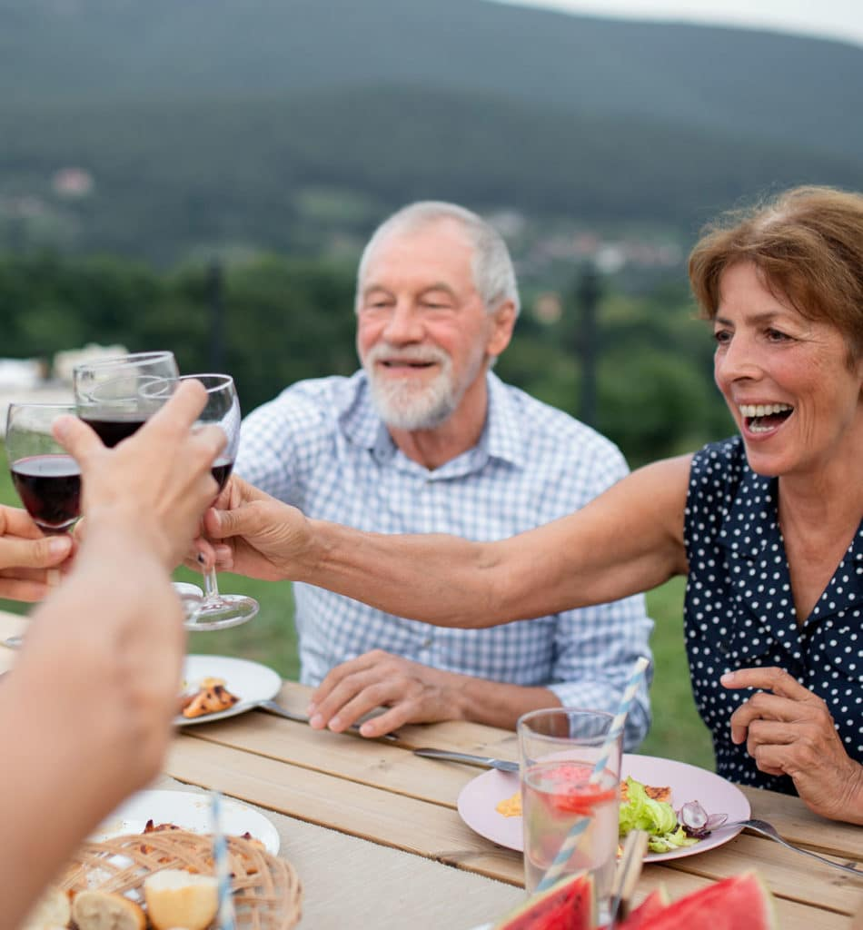 Happy people enjoying wine